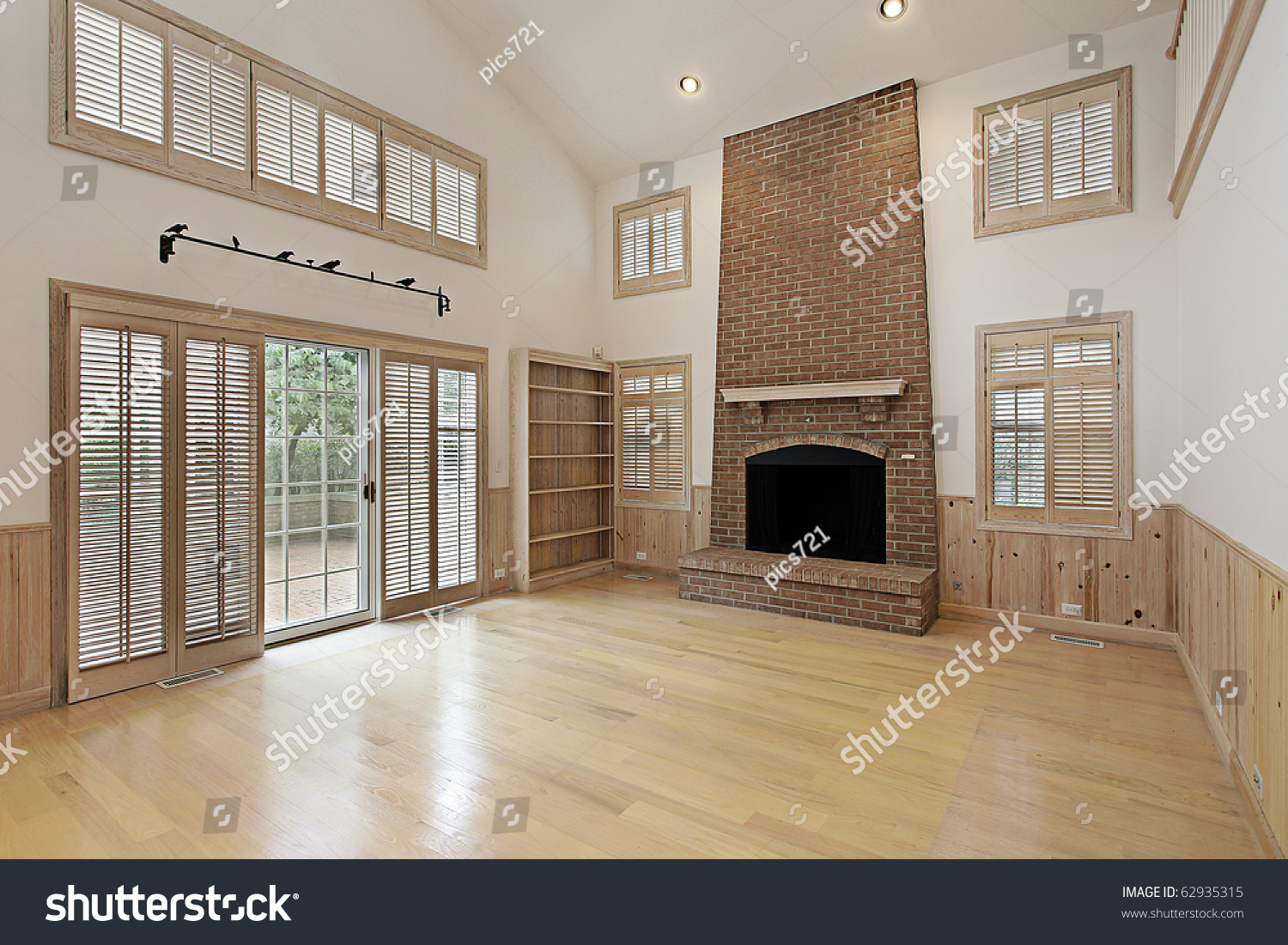 two story family room brick fireplace stock photo 62935315