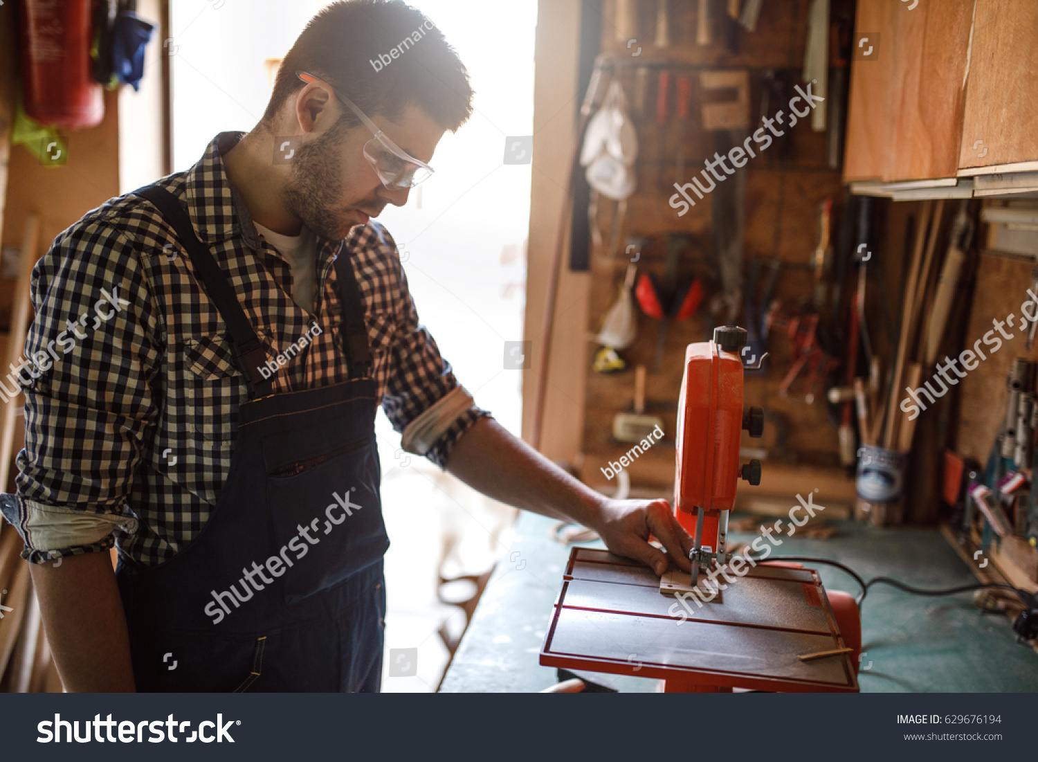 Photo Young Carpenter Working Drilling Machine Stock Photo Edit Now