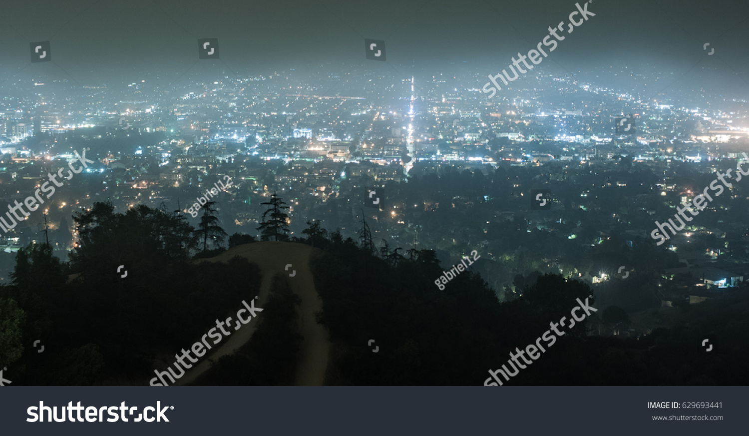 View Of Hazy City Lights Of Los Angeles At Night From Griffith Park