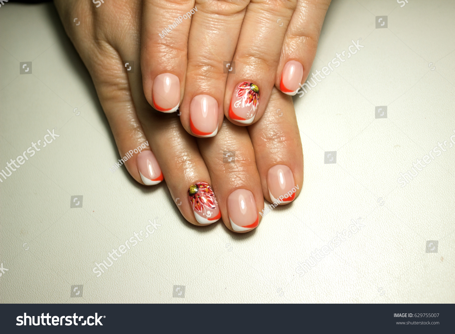 Beautiful nail design french manicure red stock photo 629755007 beautiful nail design french manicure with red flower and rhinestones prinsesfo Choice Image