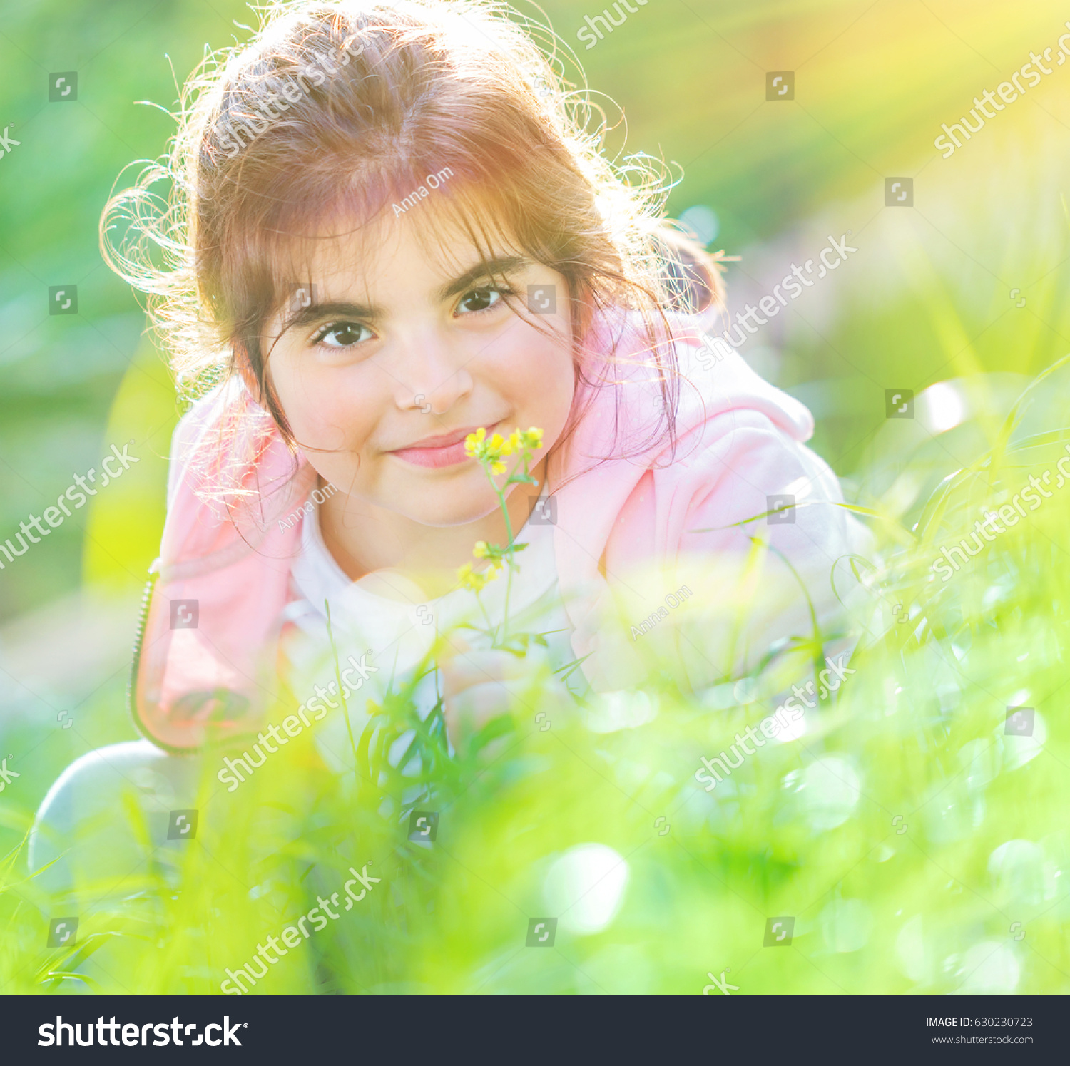 portrait cute baby girl enjoying flowers stock photo & image