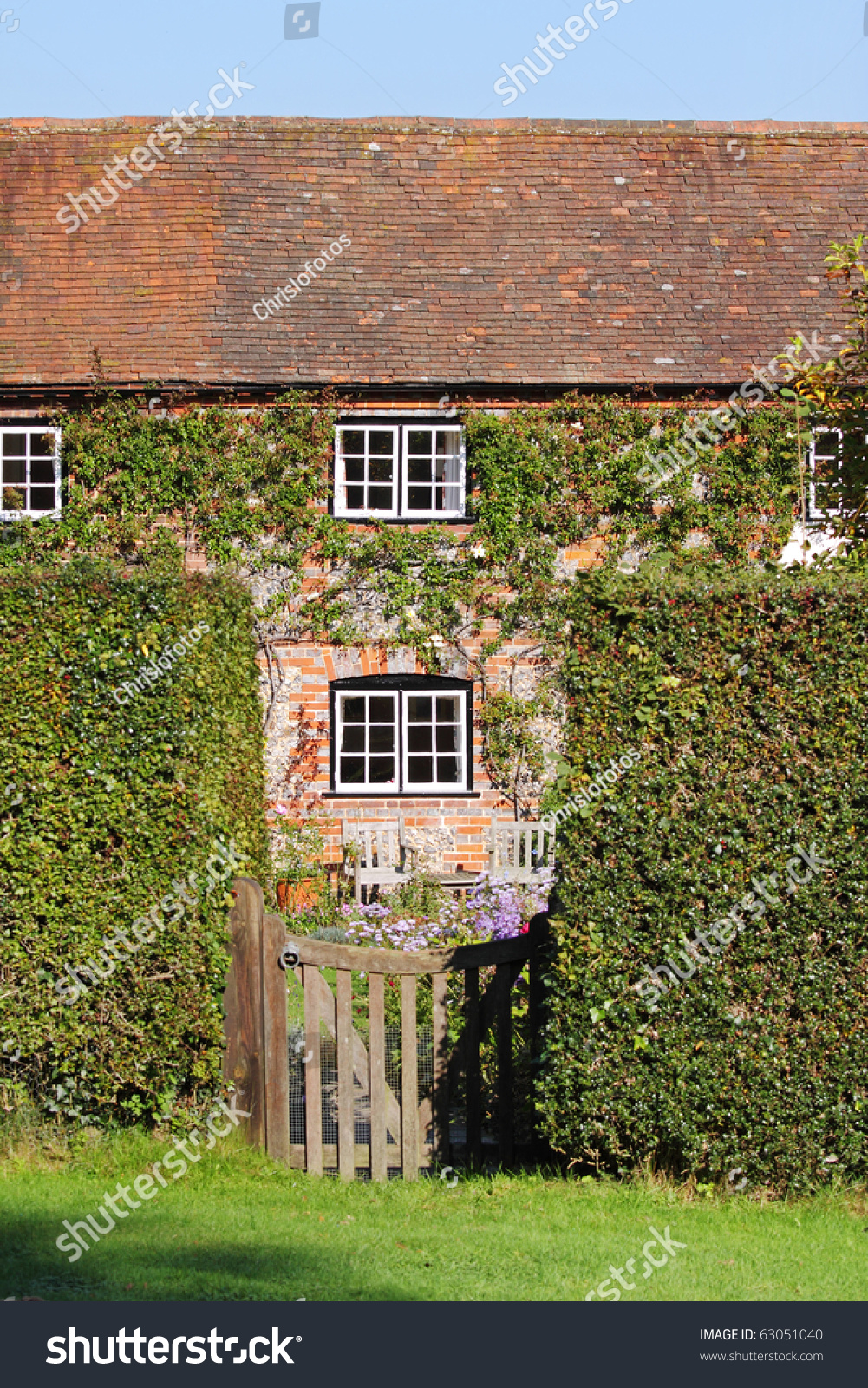 Traditional English Village Cottage And Garden With