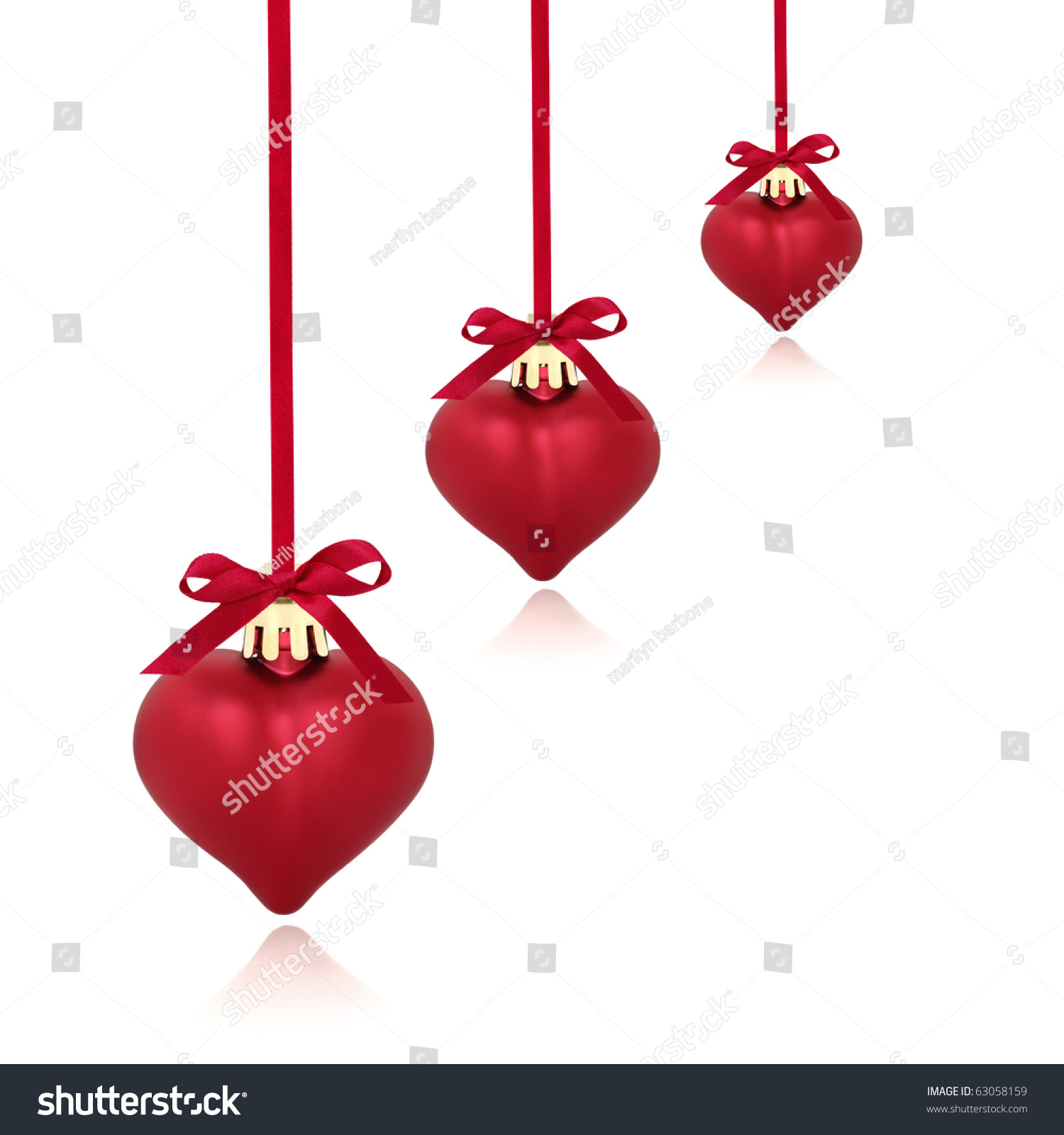 Christmas heart shaped red baubles with ribbon and bows