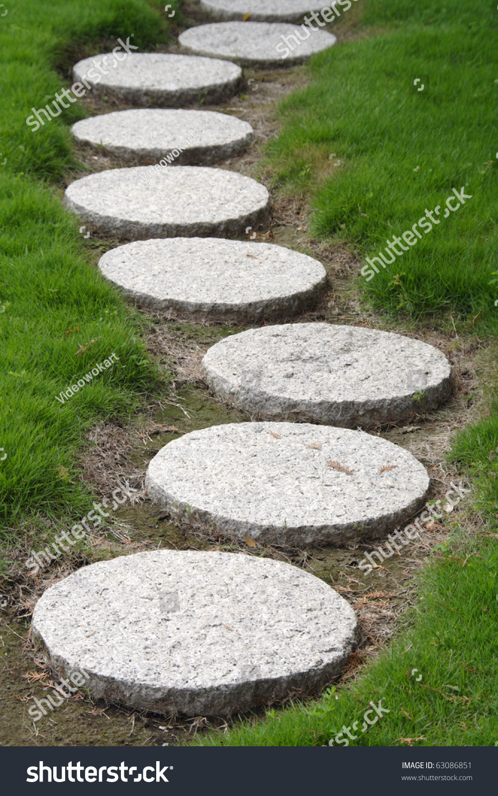 Stepping stone walkway stock photo 63086851 shutterstock for How to build a stepping stone path