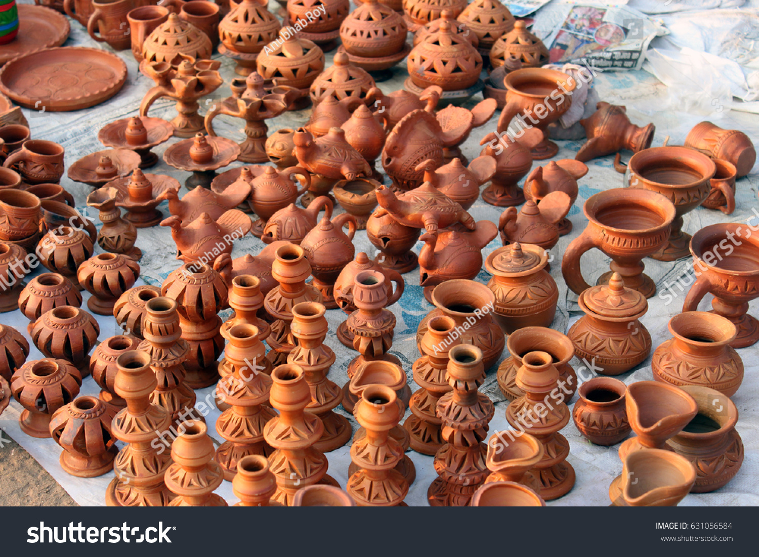 Rows of red clay pottery  Different types of handcraft in the market. Rows Red Clay Pottery Different Types Stock Photo 631056584