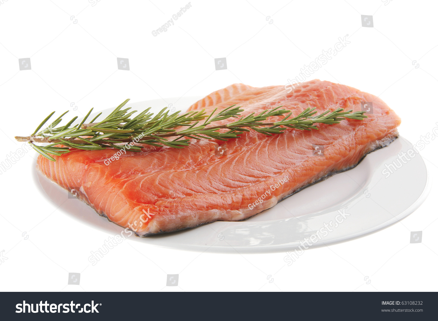 Fresh raw red fish fillet on white plate and rosemary for Red fish fillet