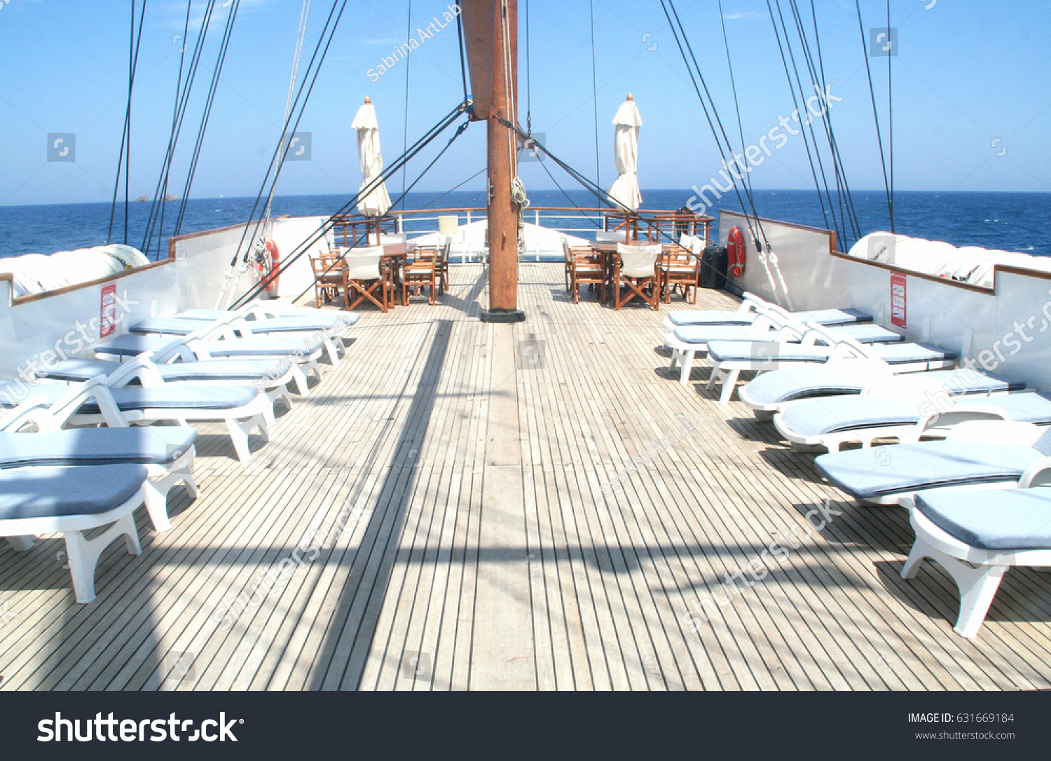 Classic Wooden Yacht Deck With Deck Chairs. Deck Chairs On A Sunny Yacht  Deck.