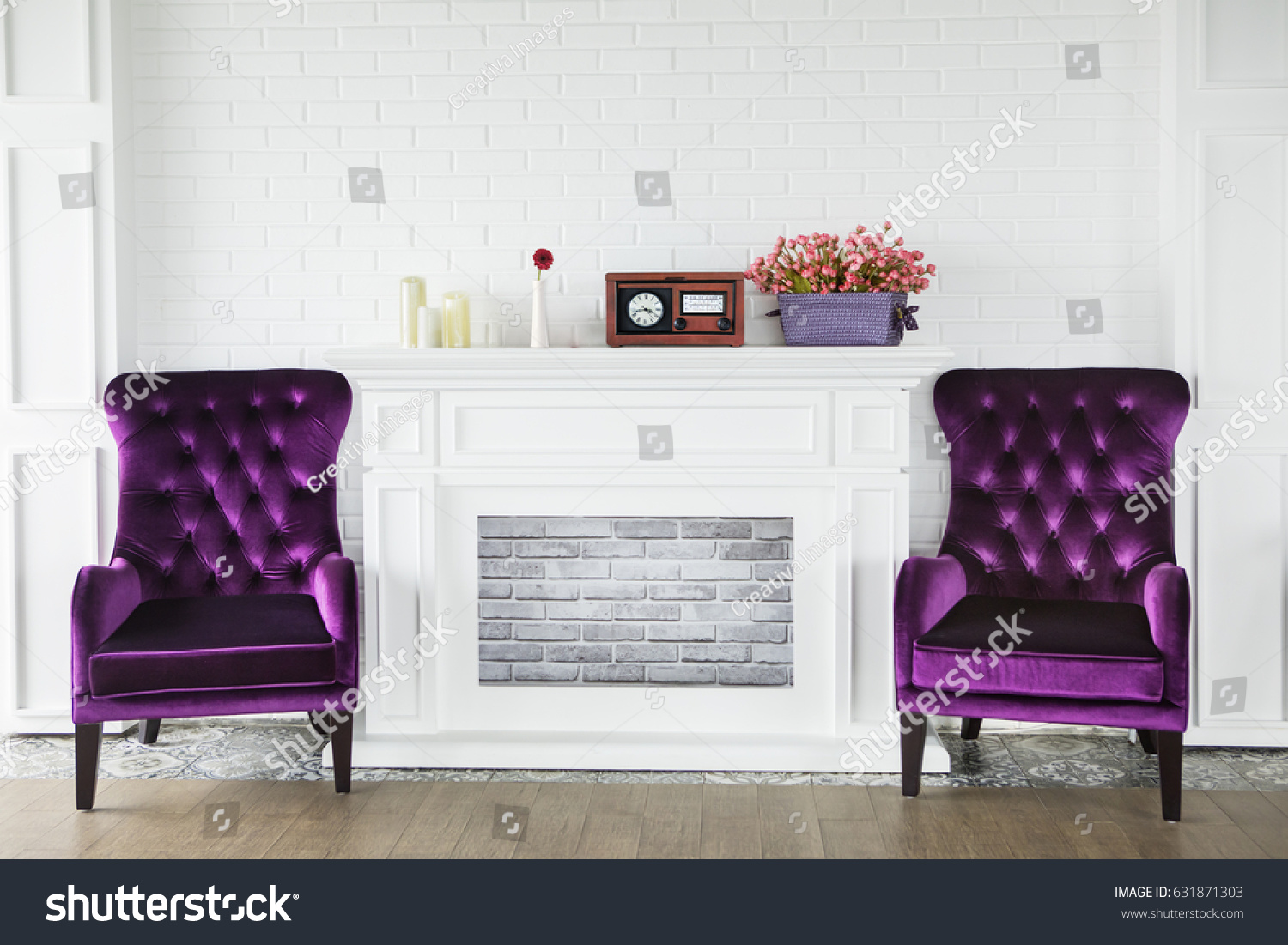 Attractive Image Of Two Purple Armchairs Near A Fireplace With Candles, Radio Player  And Flowers In