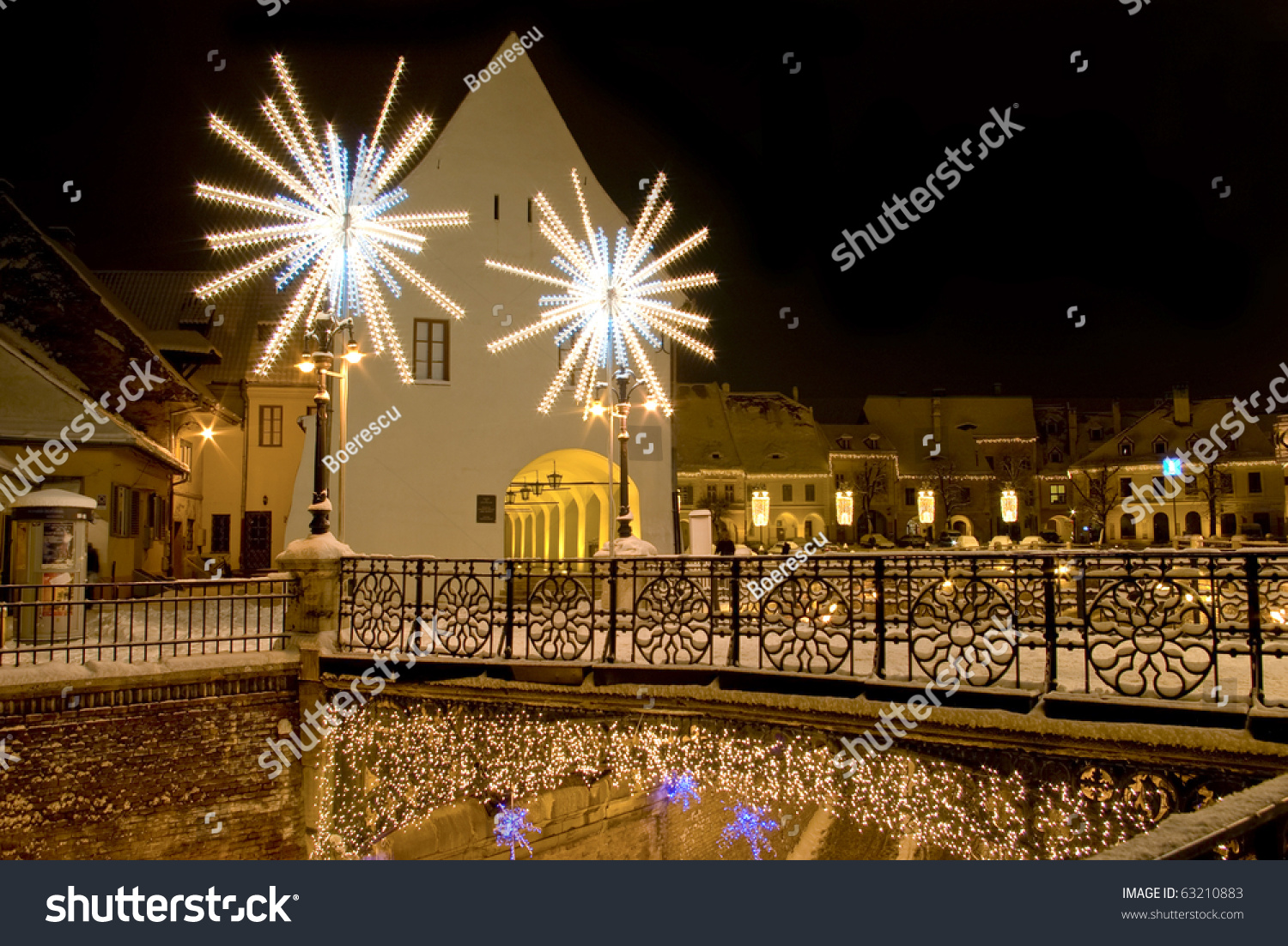 winter snow christmas lights on street and bridge in sibiu in winter long exposure image by - Long Christmas Lights