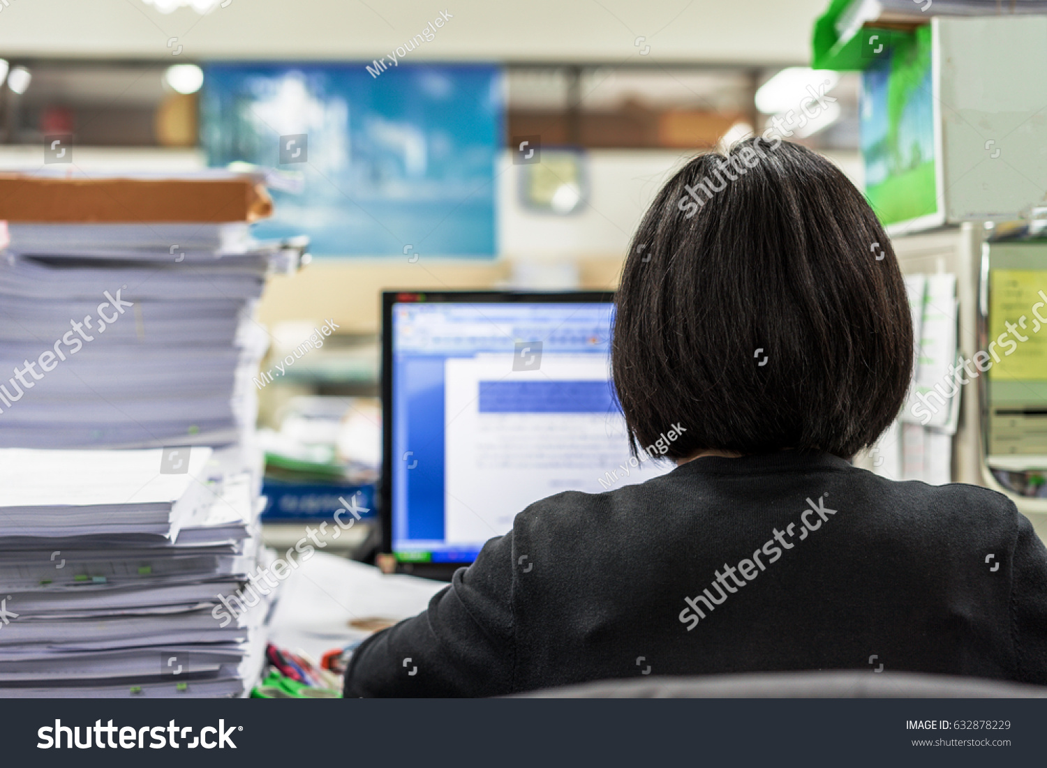 Young woman pile paper lying on stock photo 632878229 shutterstock a young woman and a pile of paper lying on a cluttered office table at working publicscrutiny Images