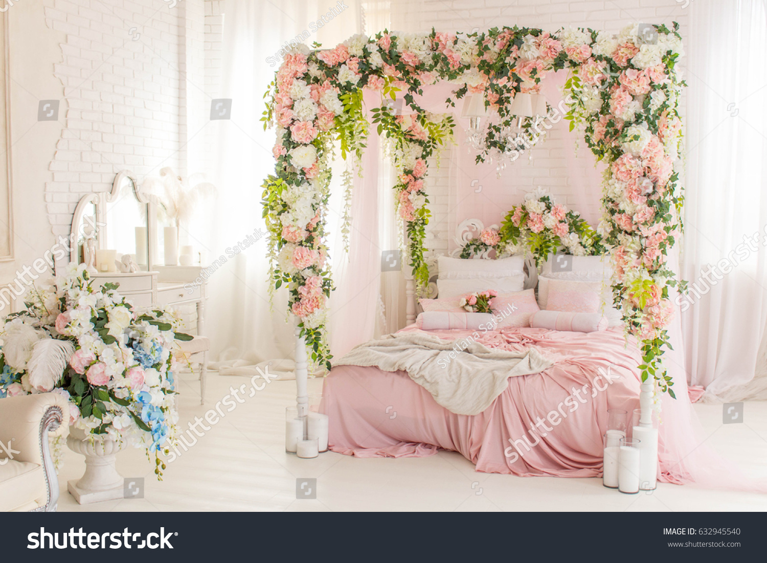 Bedroom Dressing Table With Pink Bed And Flower Decoration