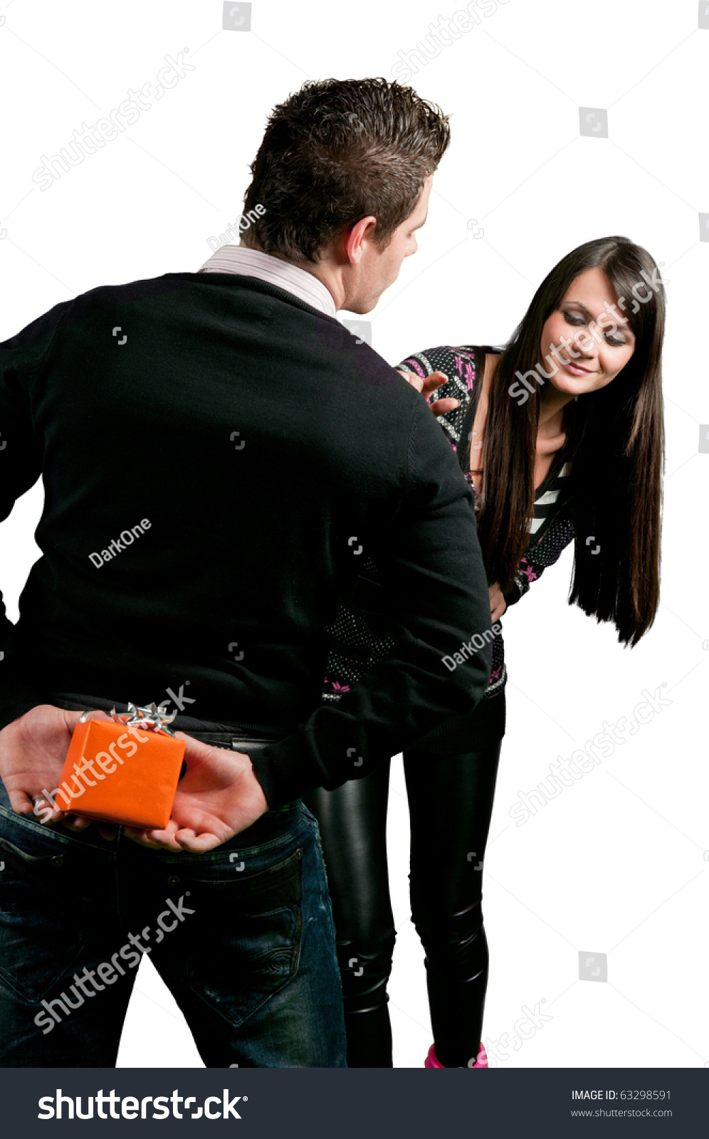 Man Hiding A Gift For Girl Behind His Back Isolated On