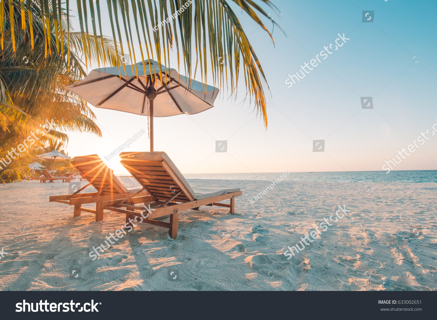 Beautiful beach. Chairs on the sandy beach near the sea. Summer holiday and vacation concept for tourism. Inspirational tropical landscape #633002651 - 123PhotoFree.com