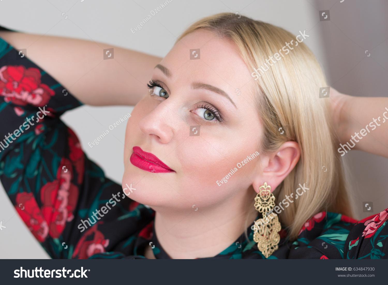 portrait of pretty blonde woman in bright dress