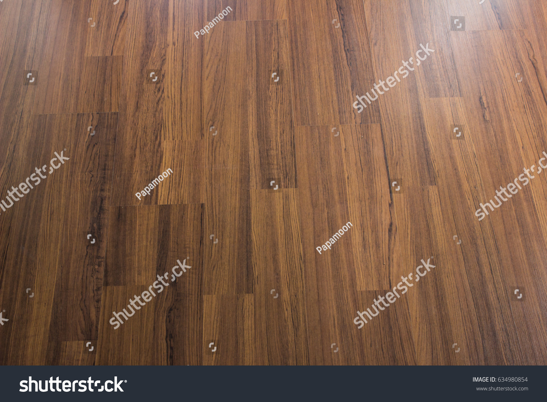 Texture Of Dark Brown Walnut Laminate Floor