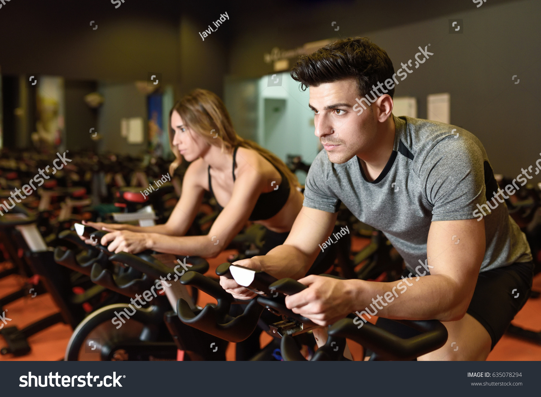 Attractive Woman Man Biking Gym Exercising Stock Photo 635078294