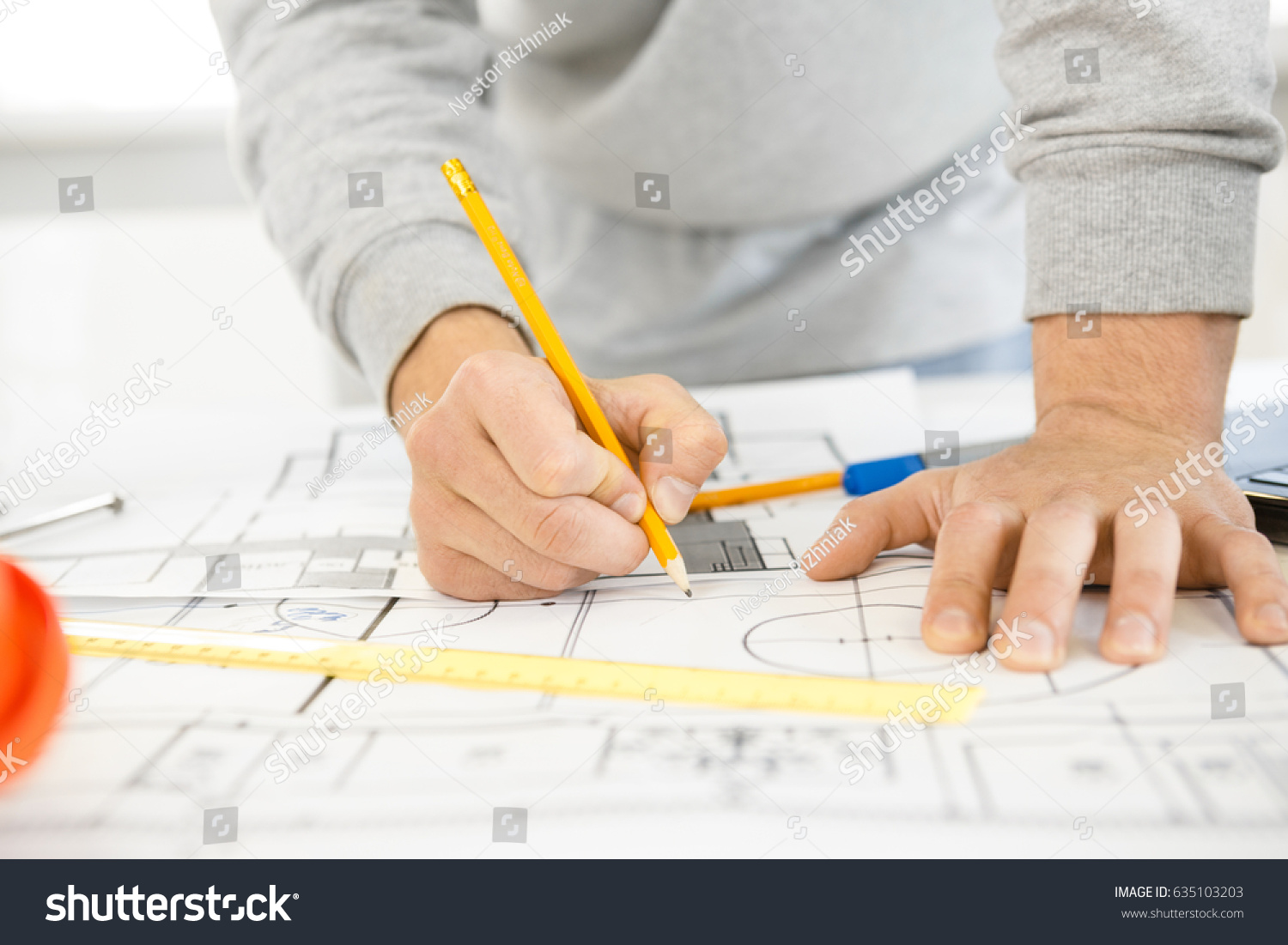 Cropped close hands male architect drawing stock photo 635103203 cropped close up of hands of a male architect drawing on blueprints designing architectural project sketching malvernweather Images