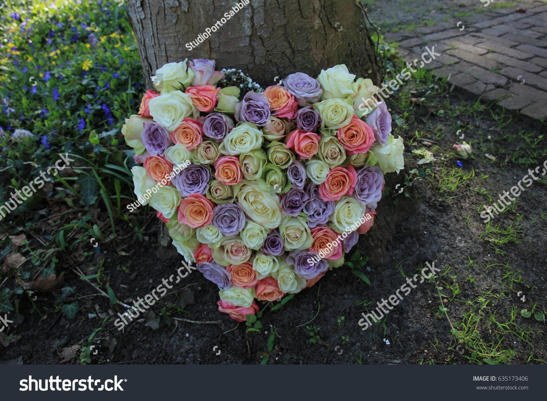 Heart shaped sympathy flowers funeral flowers stock photo 635173406 heart shaped sympathy flowers or funeral flowers near a tree izmirmasajfo Gallery