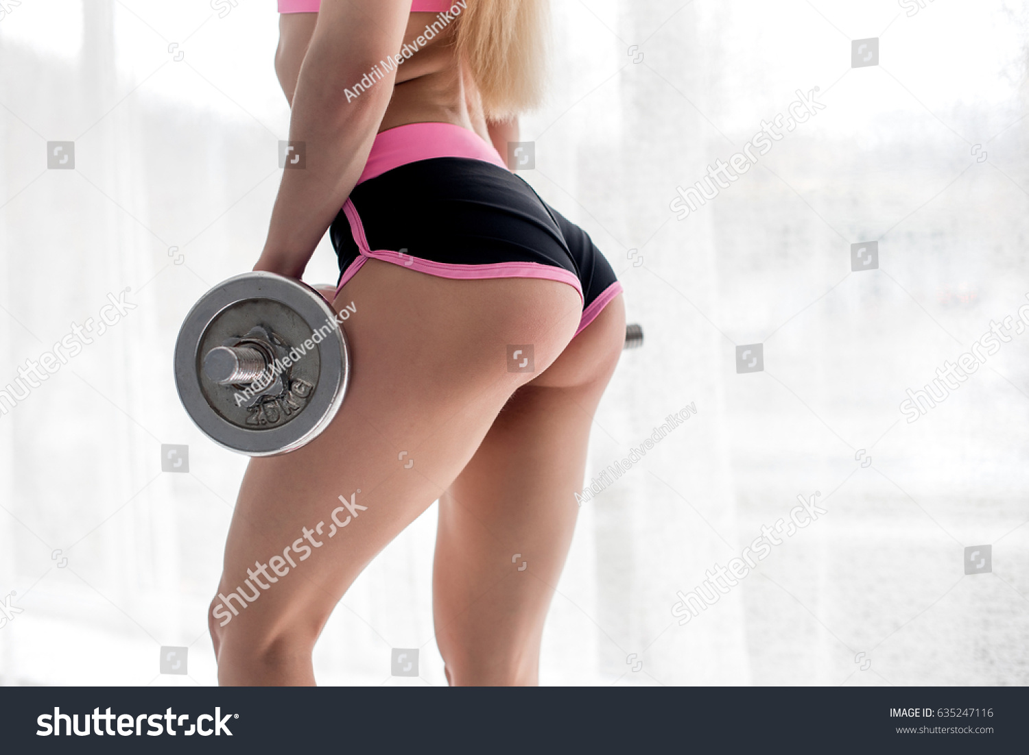 sexy ass sportswoman studio dumbbells stock photo (safe to use
