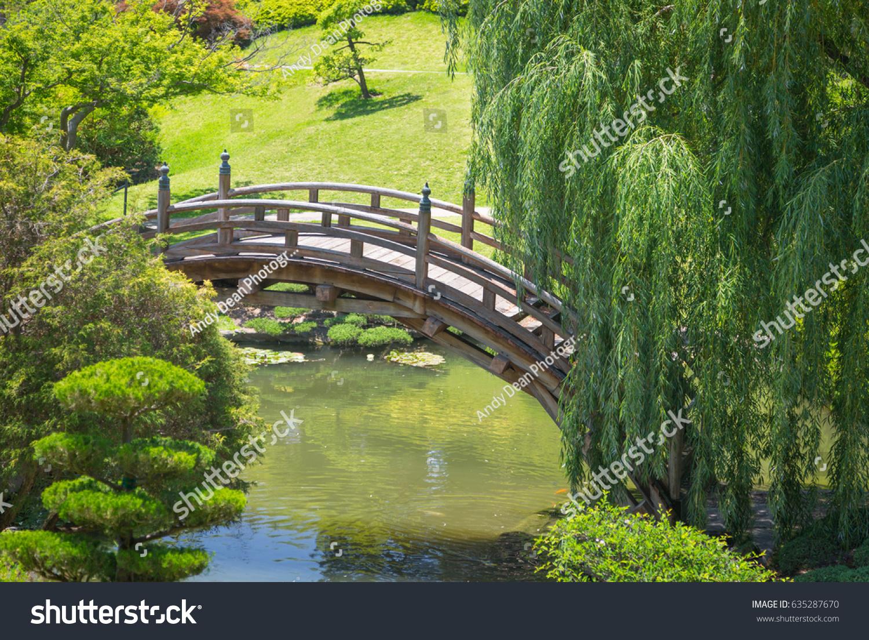 Beautiful japanese garden pond bridge stock photo for Japanese garden pond bridge