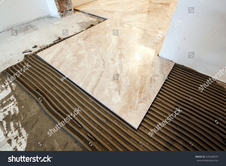 Ceramic tiles tools tiler floor tiles stock photo 635468879 ceramic tiles and tools for tiler floor tiles installation home improvement renovation dailygadgetfo Image collections