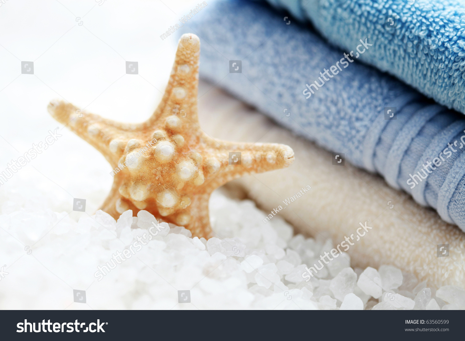 Bath salt with star fish and pile of fresh towels beauty for Salt bath for fish
