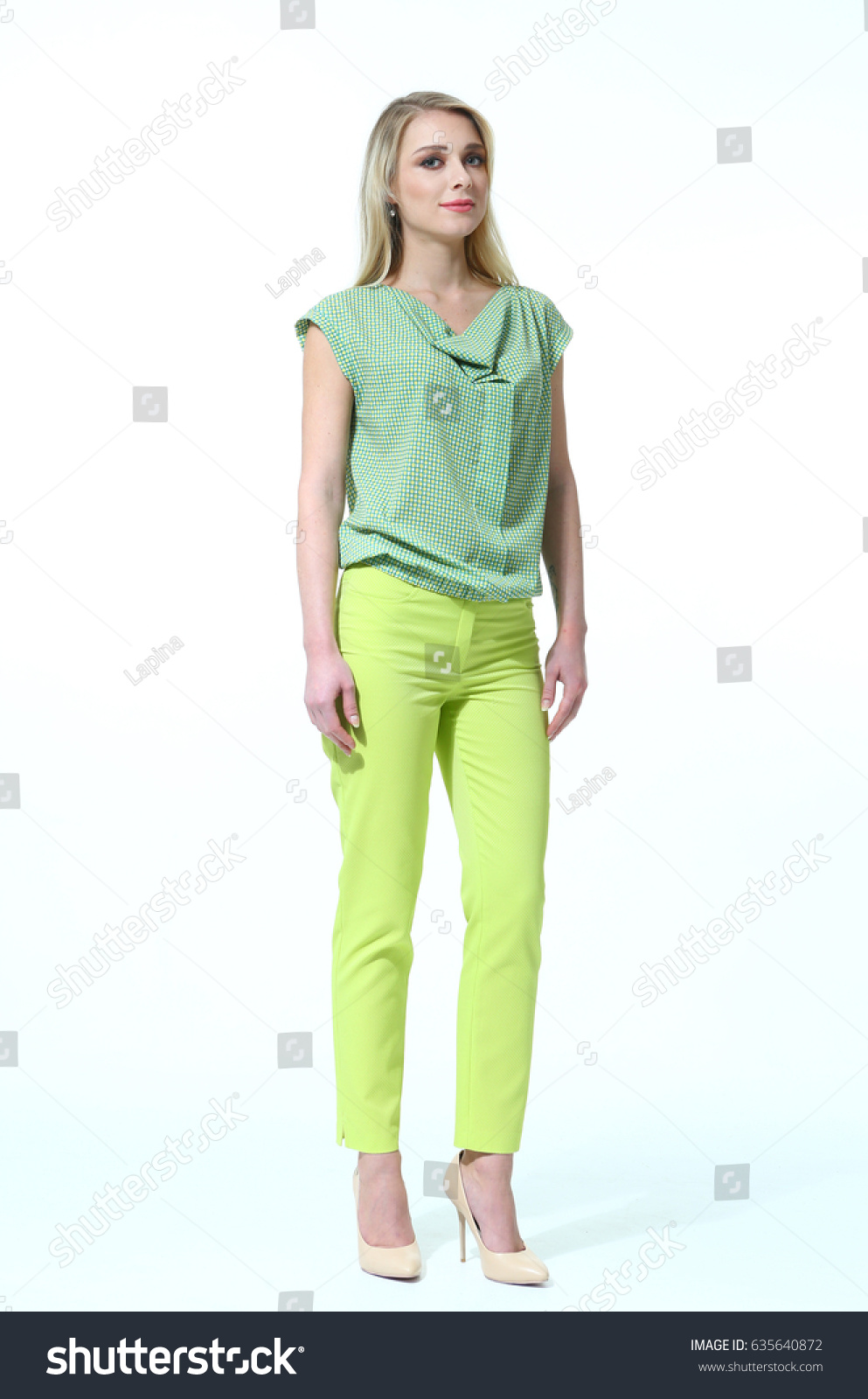 245af76aad23c0 blond european model in summer casual summer print blouse yellow trousers high  heels shoes full body photo isolated on white