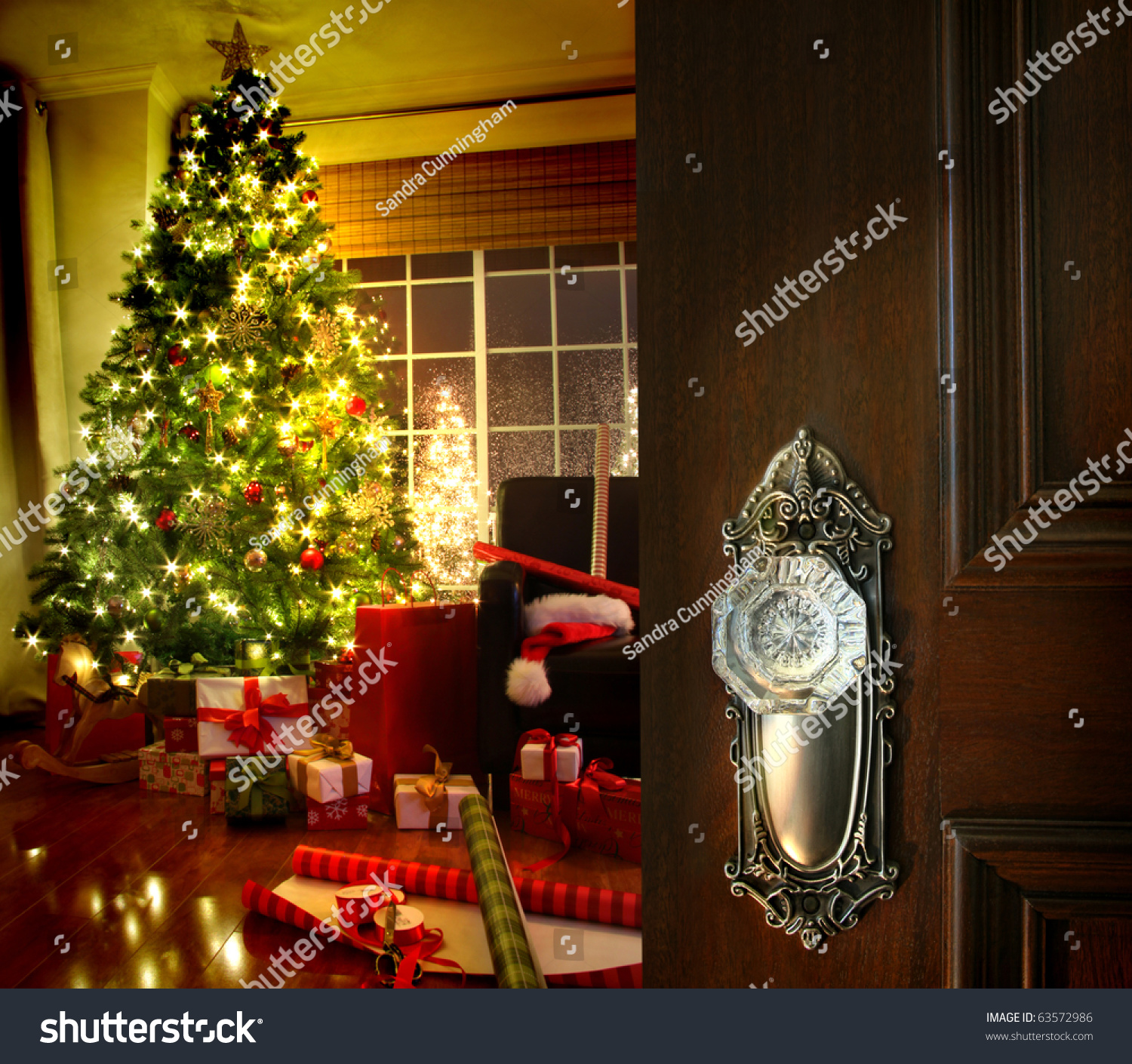 Door Opening Into A Beautiful Living Room Decorated For Christmas Stock Photo 63572986