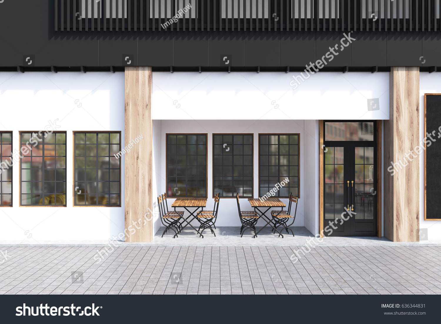 cafe exterior with white walls and two wooden tables with chairs standing near a door
