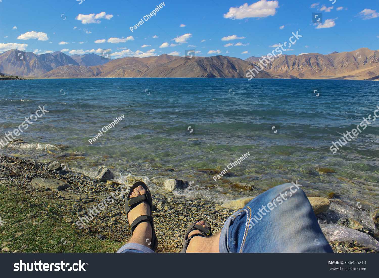 stock-photo-man-resting-on-the-bank-of-b