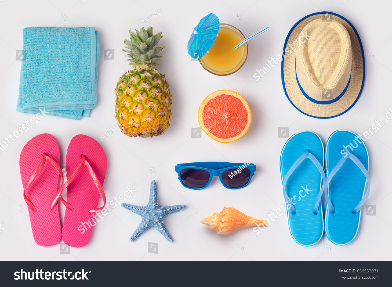 Tropical summer vacation concept with pineapple, juice and flip flops organized on white background. View from above. Flat lay #636552071