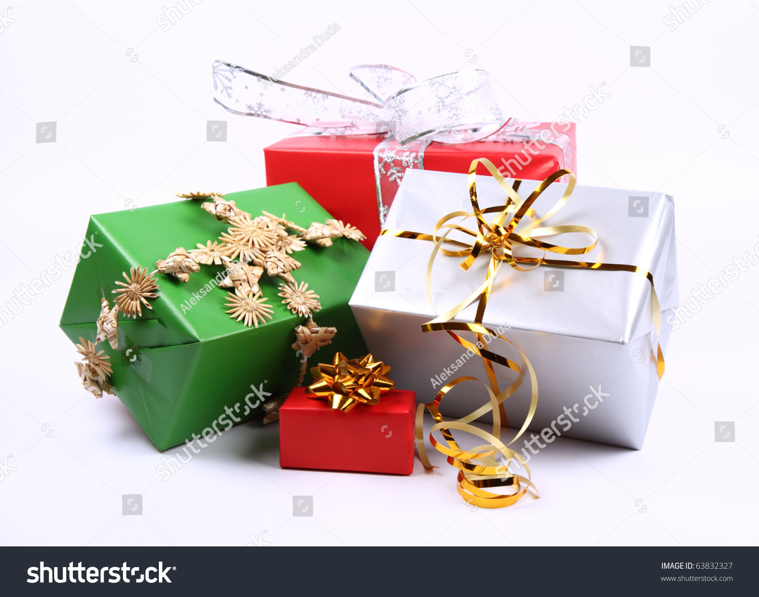Gifts In Silver Green And Red Wrapping With Bows On White