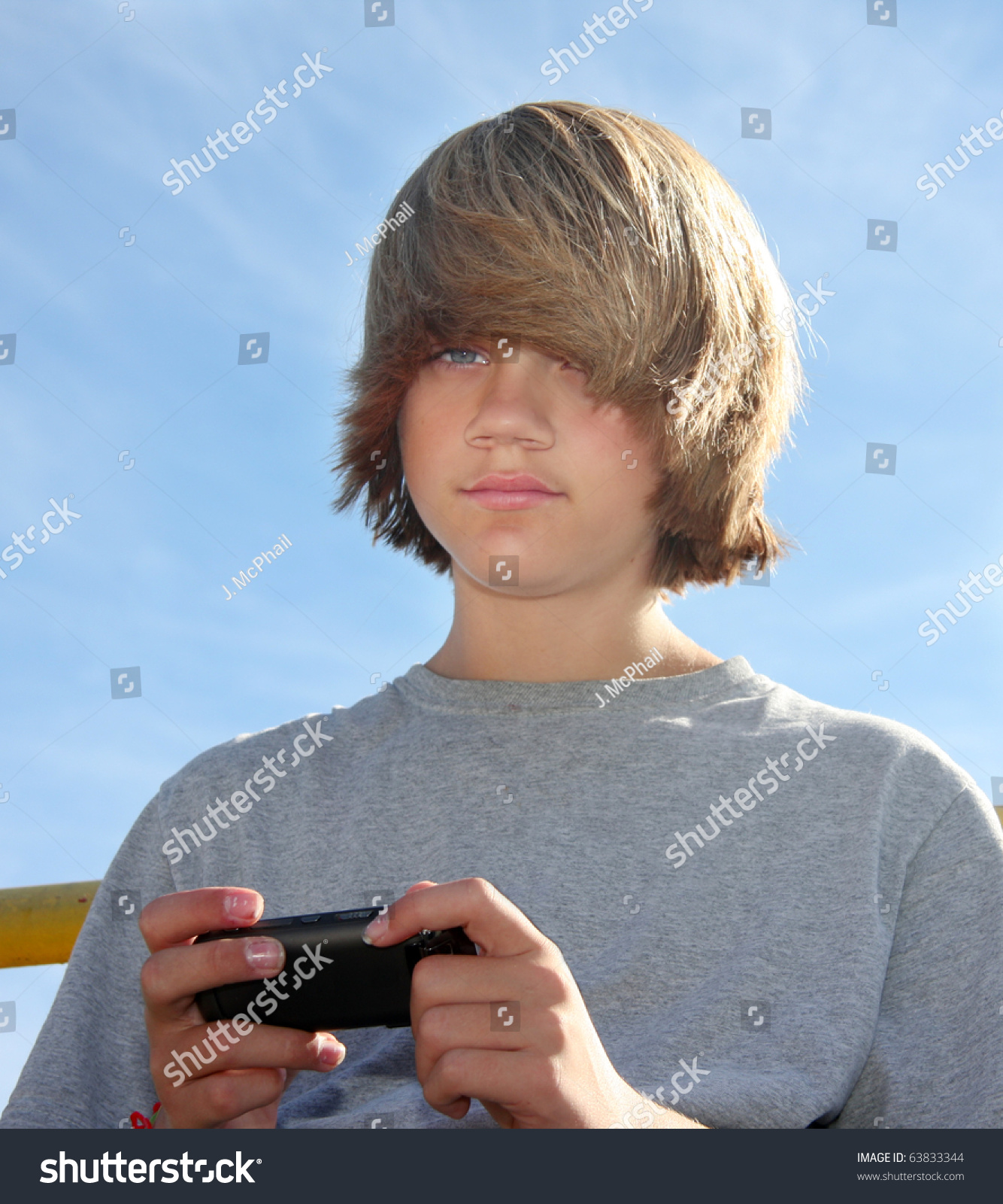 Cute Teen Boy Cell Phone Texting Stock Photo (Edit Now) 11