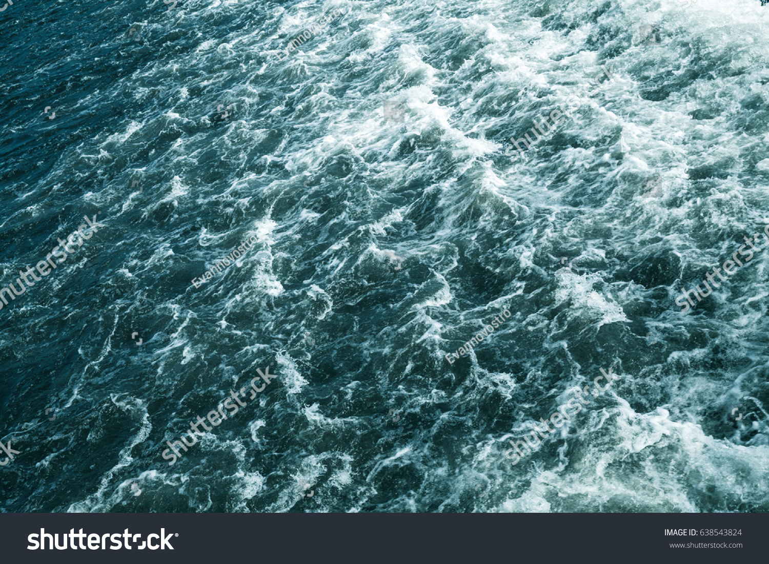 Stormy sea, deep blue water surface with foam and waves, natural background photo #638543824