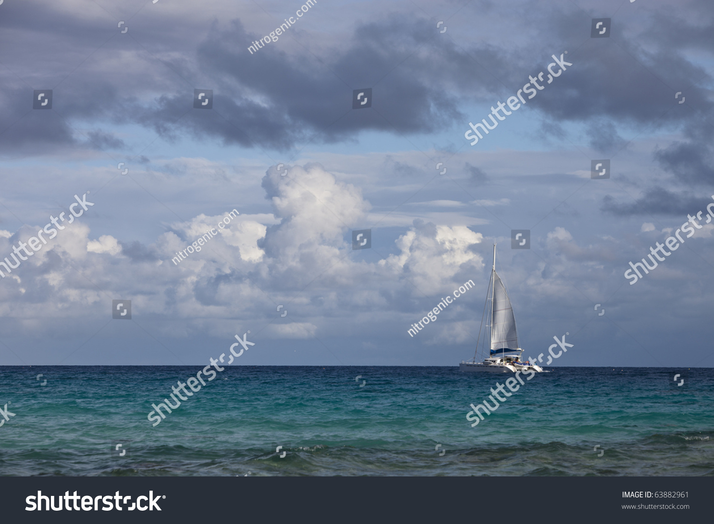 Lagoon Tropical Island: Luxury Sailboat On Blue Lagoon Of A Tropical Island Stock