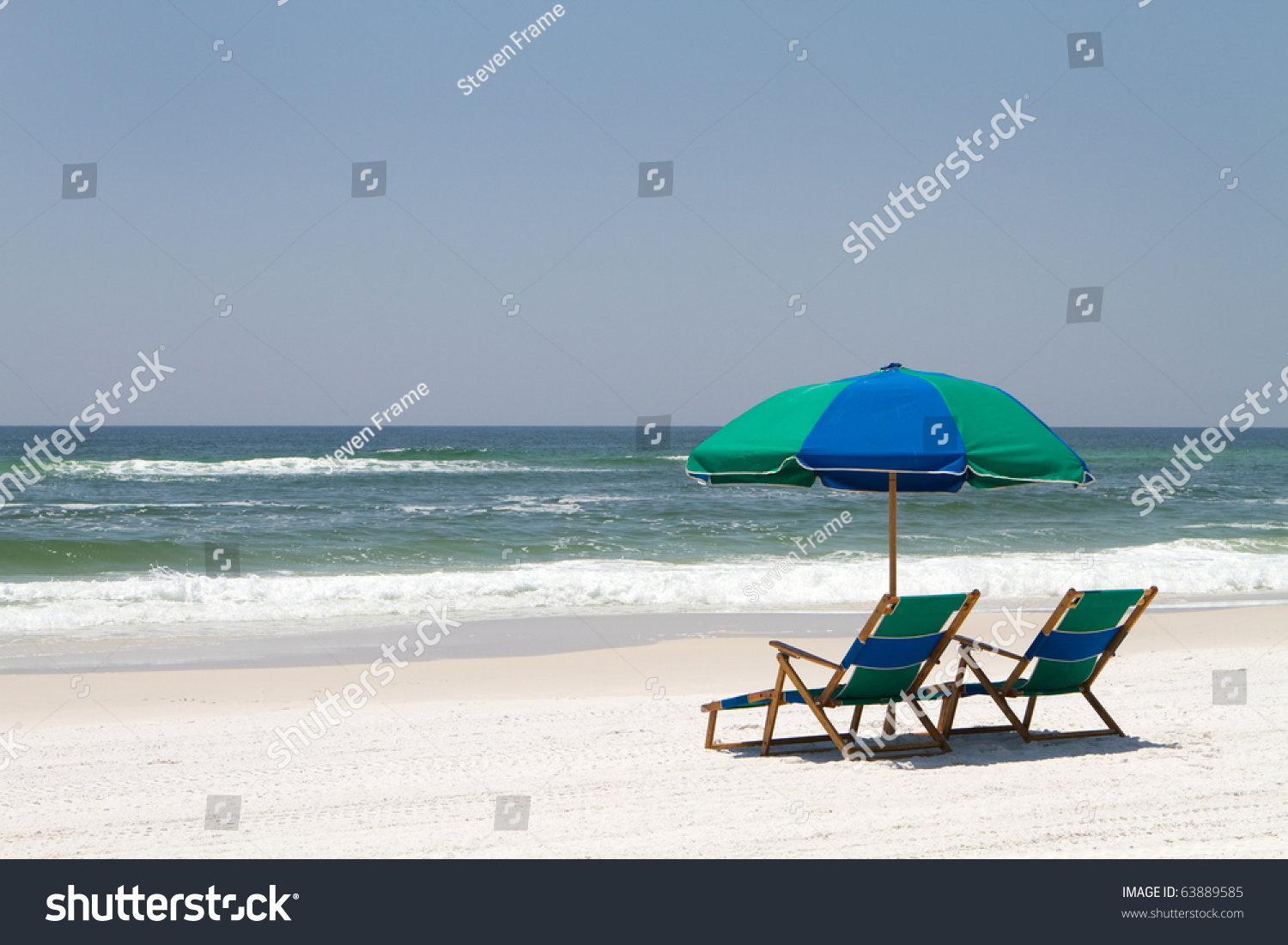 Two Beach Chairs Umbrella Sit On Stock Photo (Royalty Free) 63889585    Shutterstock