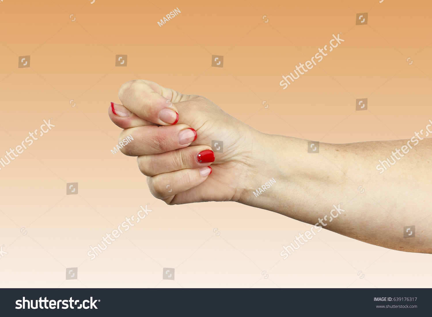 Women age hand shows fico isolated stock photo 639176317 shutterstock women age hand shows the fico isolated on orange background symbol of greed and avarice biocorpaavc Gallery