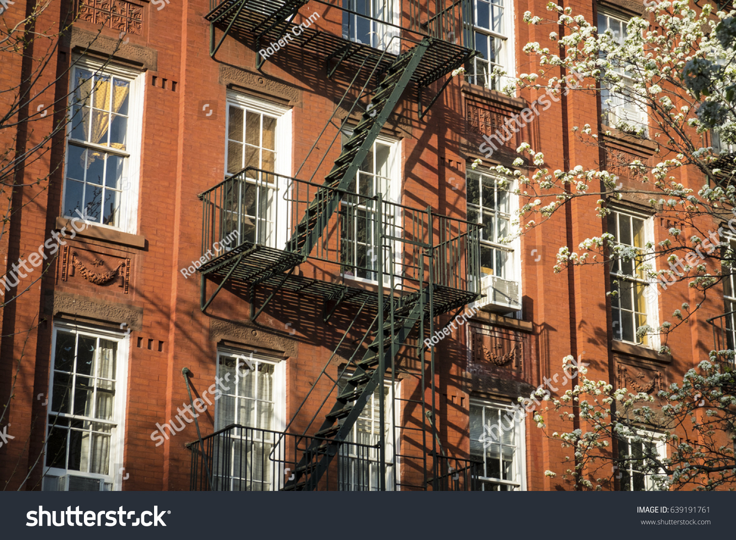 Red brick apartment building with fire escape in New York city | EZ ...