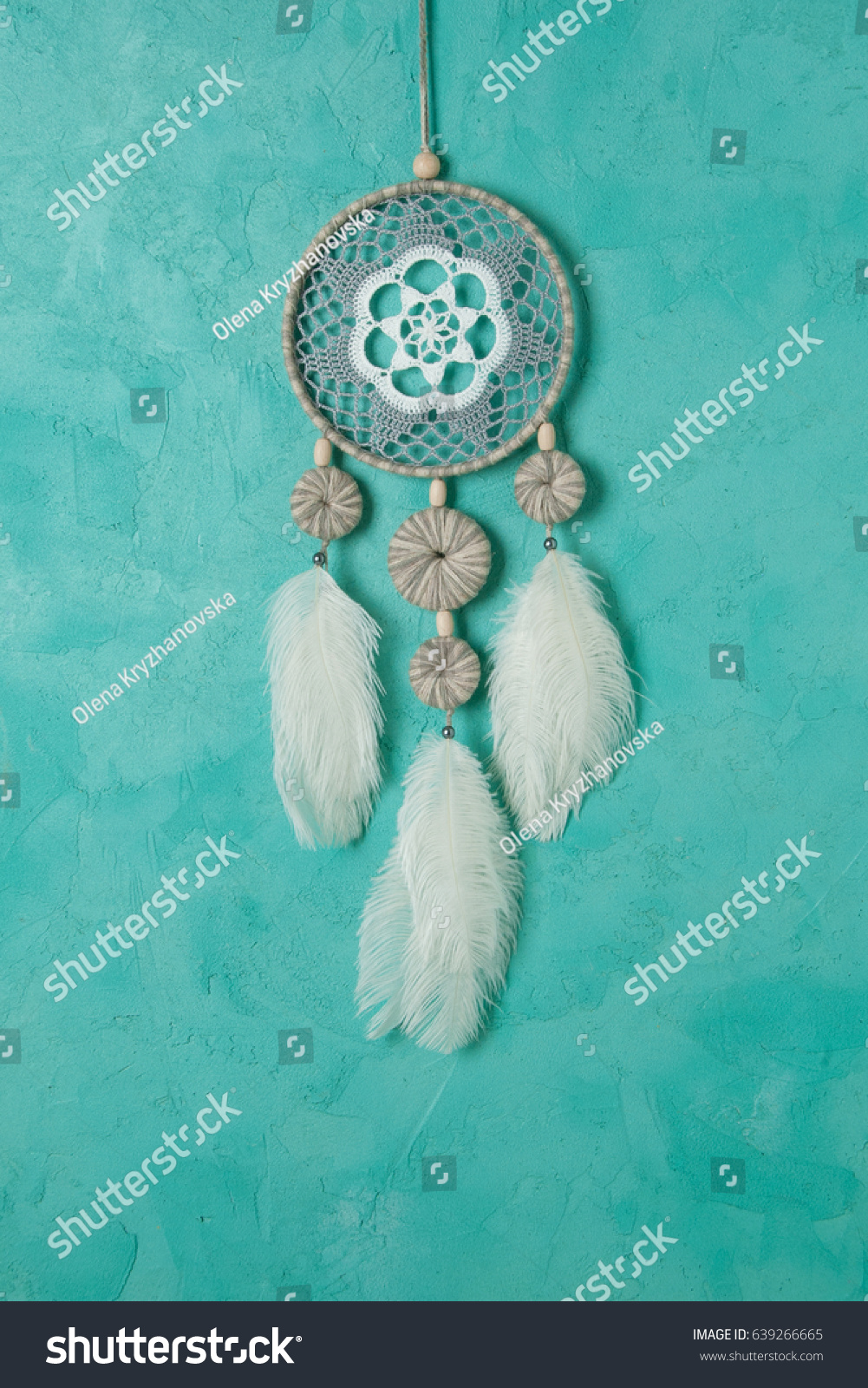 White gray dream catcher close up on aquamarine textured background. Copy space for text #639266665