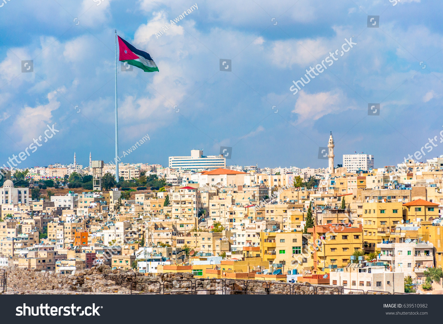 stock-photo-jordan-flag-in-amman-cloudy-