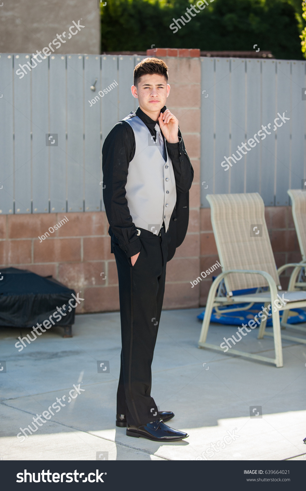 Handsome Mexican Teen Holding Jacket Over Stock Photo (Royalty Free ...