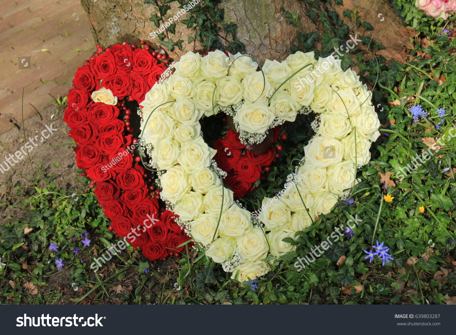 Heart shaped sympathy flowers funeral flowers stock photo royalty heart shaped sympathy flowers or funeral flowers near a tree izmirmasajfo