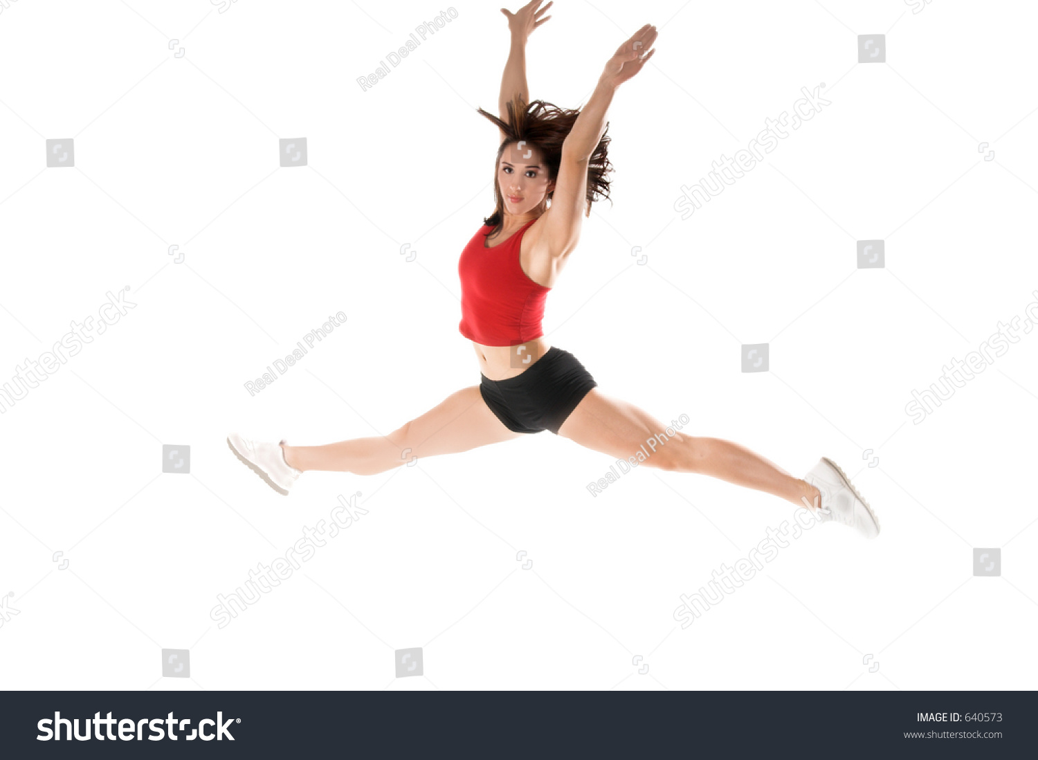 A Woman Does A Gymnastic Jump In The Gym Ez Canvas