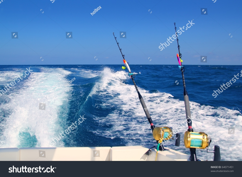 Trolling fishing boat rod golden saltwater stock photo for Ocean fishing pole