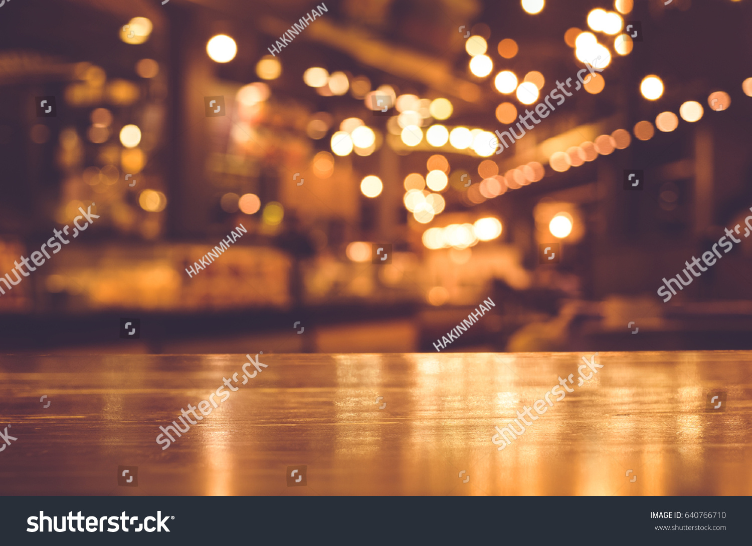 restaurant table top lighting. Wood Table Top With Reflect On Blur Of Lighting In Night Cafe,restaurant Background/ Restaurant Y