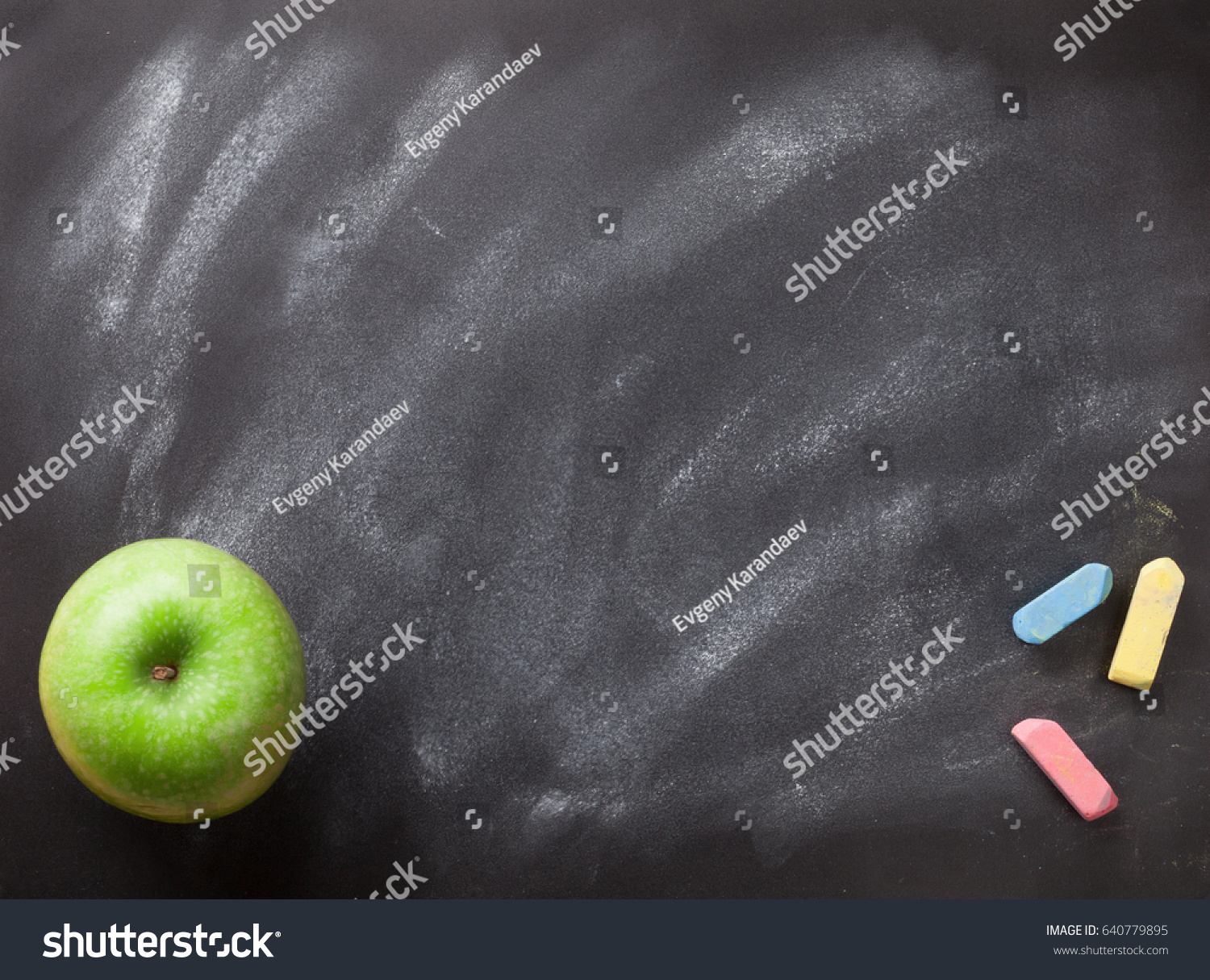 Green Apple On Blackboard Or Chalkboard Background Back To School Concept Top View With
