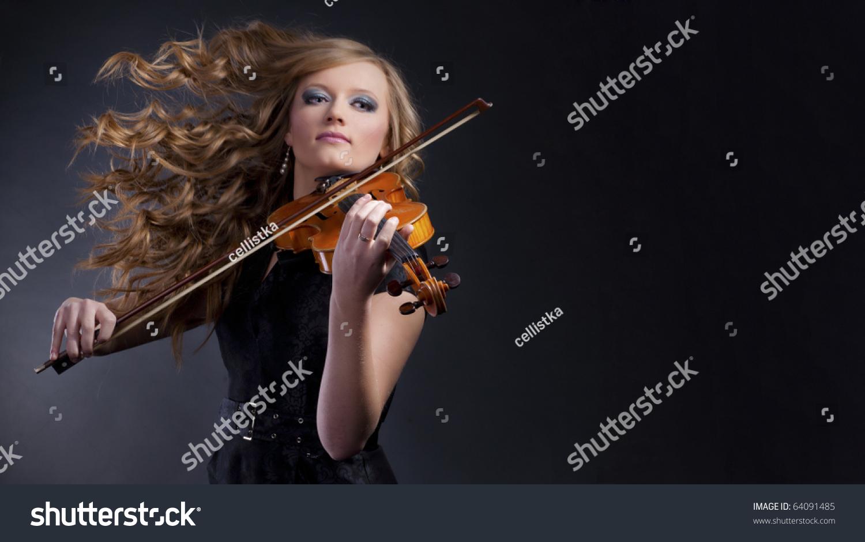 Dynamic beautiful woman playing violin stock photo Vibeline