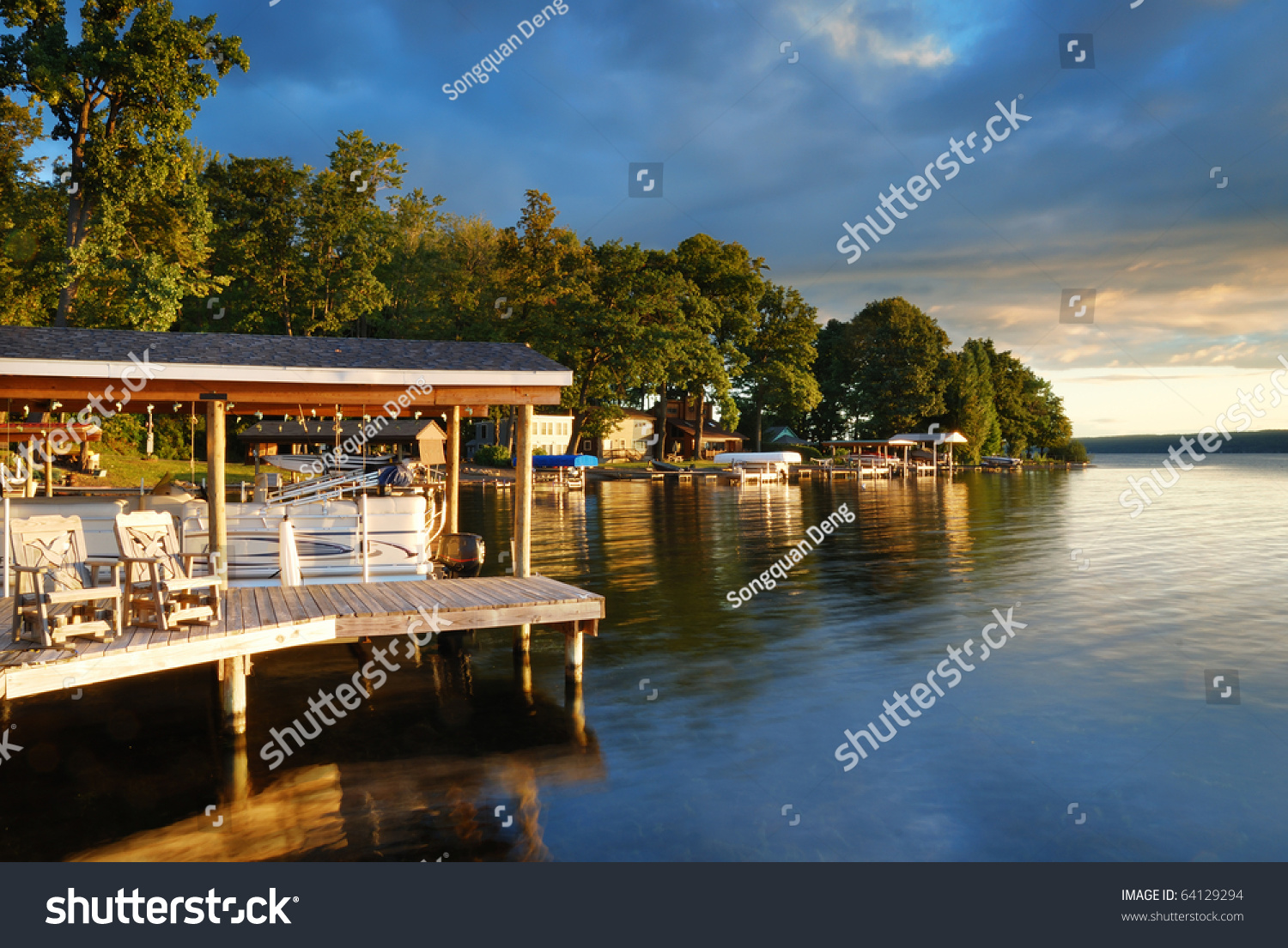 Lake House With Pier And Woods With Sunrise In The Morning