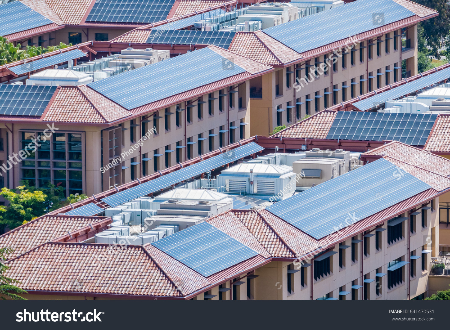 Solar Panels Installed On Tiled Rooftops Stock Photo (Royalty Free ...