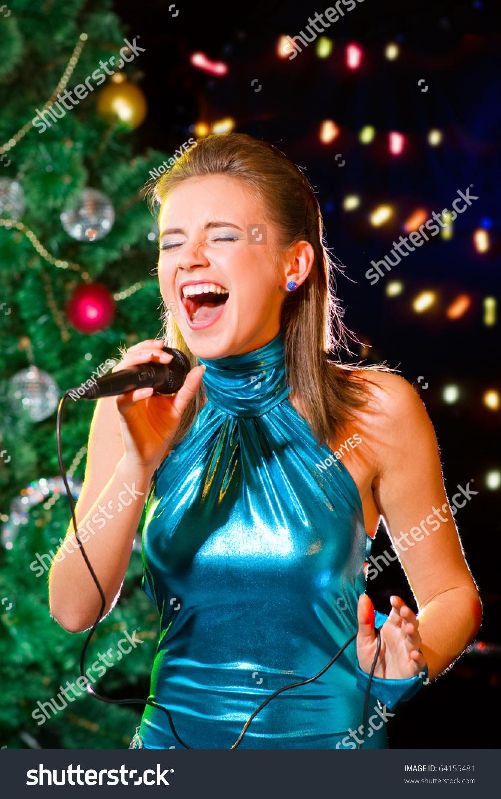 Young Woman Singing Karaoke Near Christmas Stock Photo (Edit Now ...